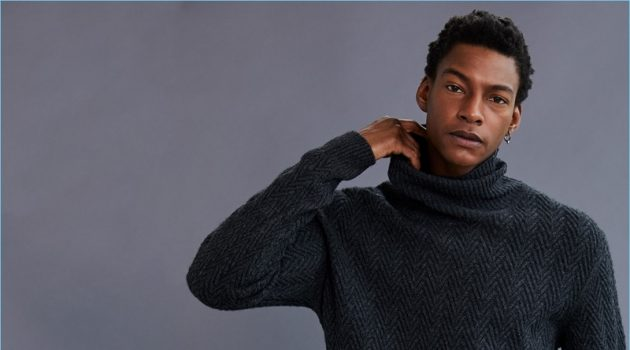 Ty Ogunkoya wears an Ermenegildo Zegna turtleneck sweater.