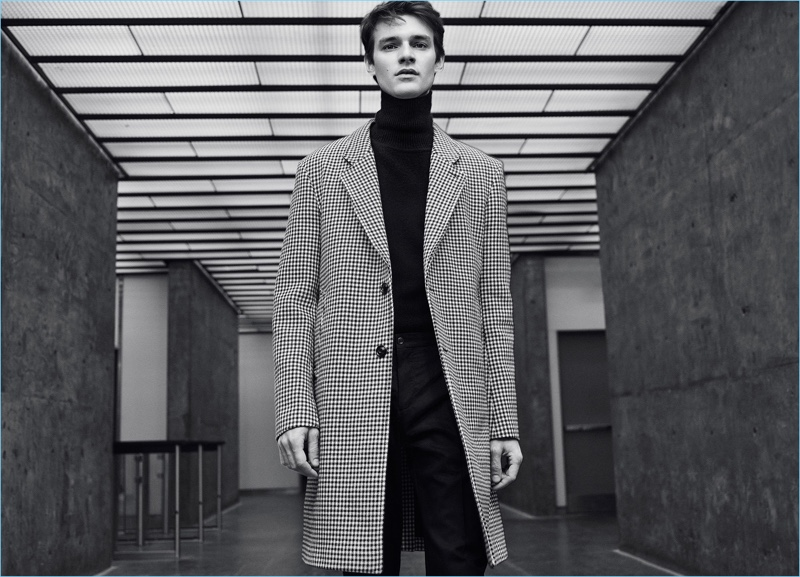 Douglas Neitzke is chic in a Zara Man check coat and turtleneck.