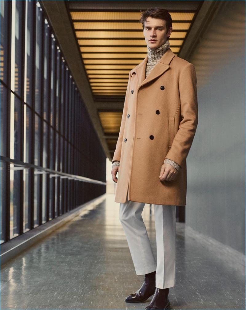 Brazilian model Douglas Neitzke wears a camel coat and turtleneck sweater from Zara Man.