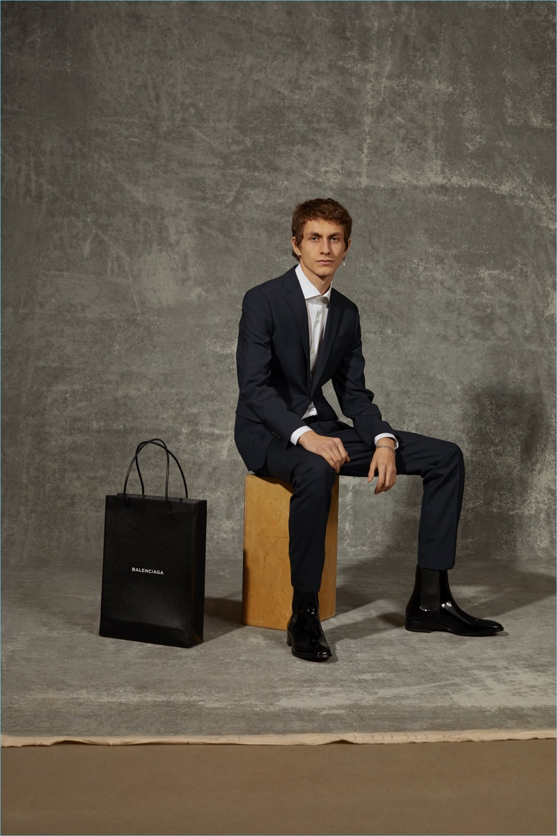 Henry Kitcher dons a Dsquared2 suit, Luigi Borelli shirt, and Christian Louboutin shoes for APROPOS Journal.