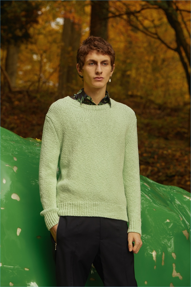 Front and center, Henry Kitcher wears a Stella McCartney sweater, shirt, and pants.