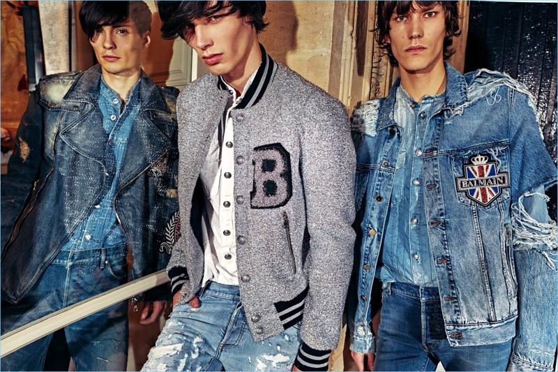 Clad in denim, models Victor Goujon, Oussama Guessoum, and Elias de Poot model looks from Balmain.
