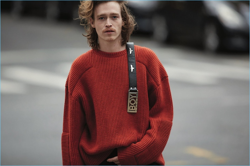 Actor Caleb Landry Jones wears a N. Hoolywood sweater with a vintage belt from What Goes Around Comes Around.
