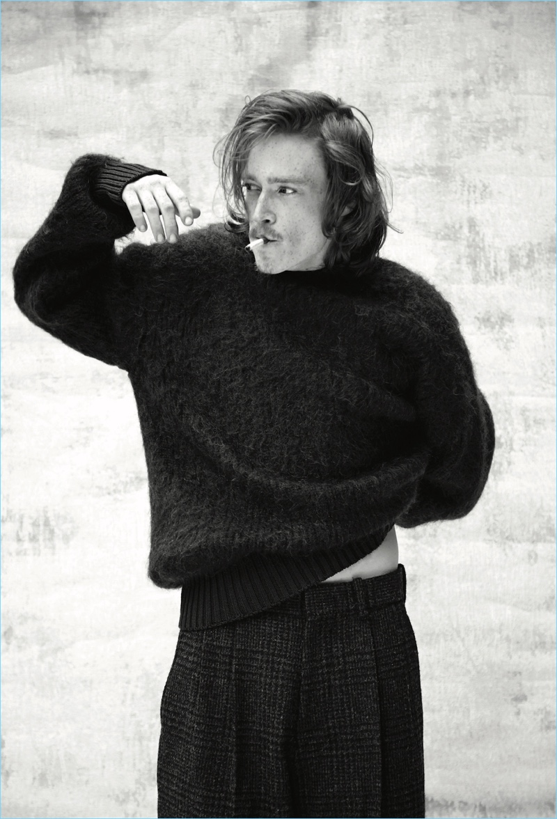 Starring in a new photo shoot, Caleb Landry Jones wears a sweater and trousers by N. Hoolywood.