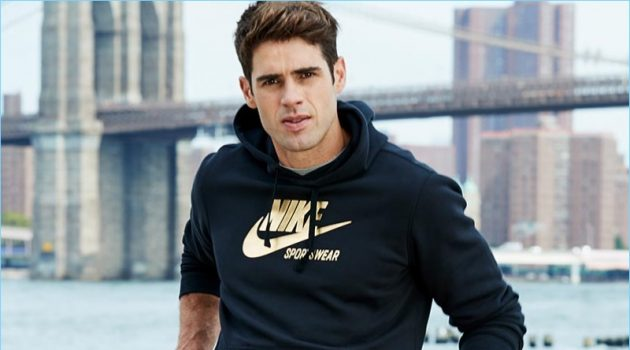 Chad White sports a Nike metallic logo sweatshirt from Macy's.