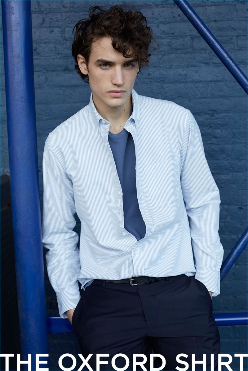 Make a smart impression with Club Monaco's stripe oxford shirt with a pocket t-shirt, suit trousers, and suede belt.