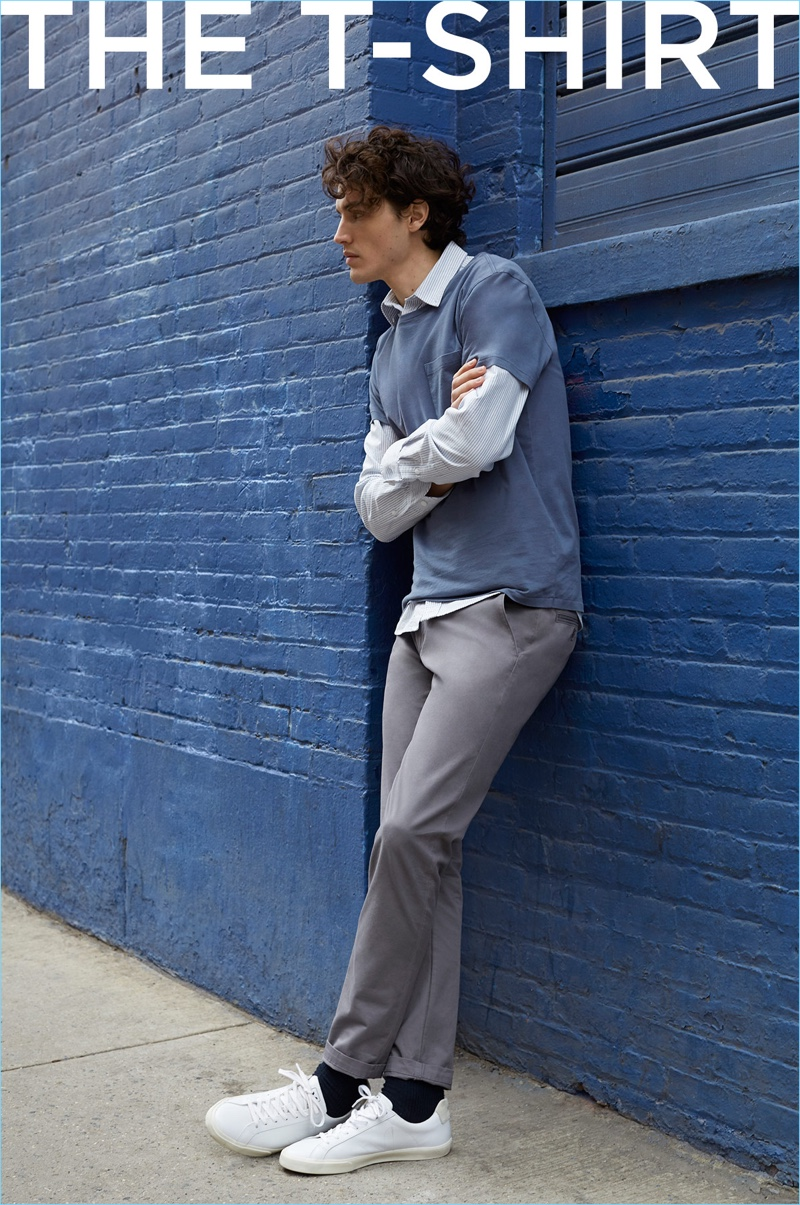 Club Monaco takes its stripe oxford shirt and pairs it with a pocket tee, stretch chinos, and Veja sneakers.
