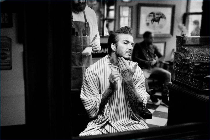 Pictured at the barber shop, David Beckham promotes House 99.