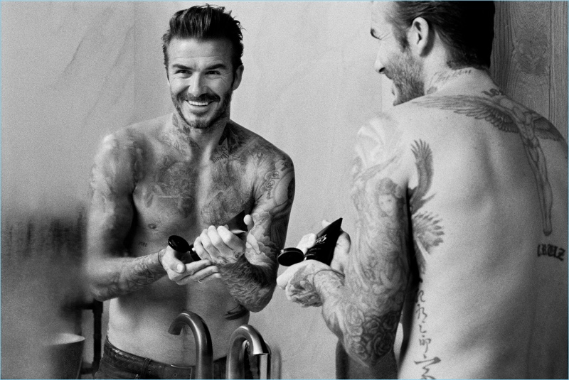 A shirtless David Beckham promotes his new grooming line, House 99.