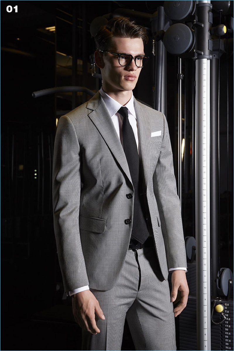 Filip Hrivnak dons a single-breasted suit in grey by Dsquared2.