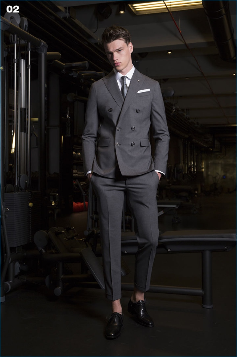A smart vision, Filip Hrivnak wears a double-breasted suit from Dsquared2.