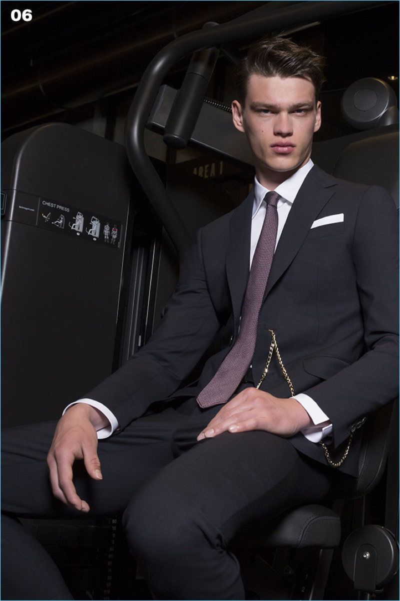 Model Filip Hrivnak takes to the gym in an elegant suit from Dsquared2.