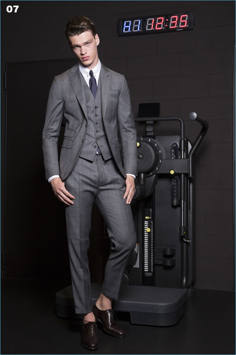 Wearing a three-piece suit, Filip Hrivnak reunites with Dsquared2.