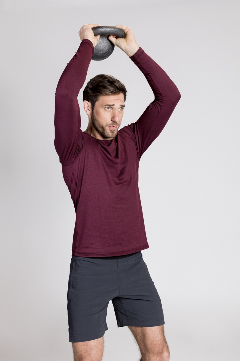 Kettle Bell Workout: Paul wears long-sleeve shirt Rhone and shorts StrongBody.