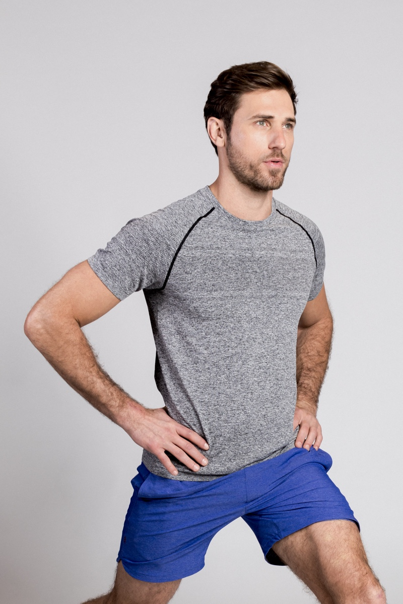 Forward Lunges: Paul wears shirt and royal blue shorts Rhone.
