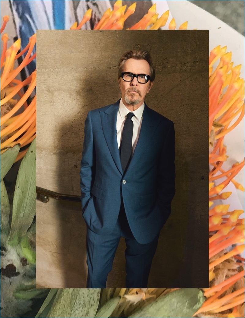 Gary Oldman wears a Canali suit with a BOSS shirt and tie.