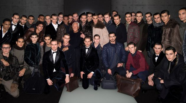 Designer Giorgio Armani appears in a picture with the models who walked for his namesake label.