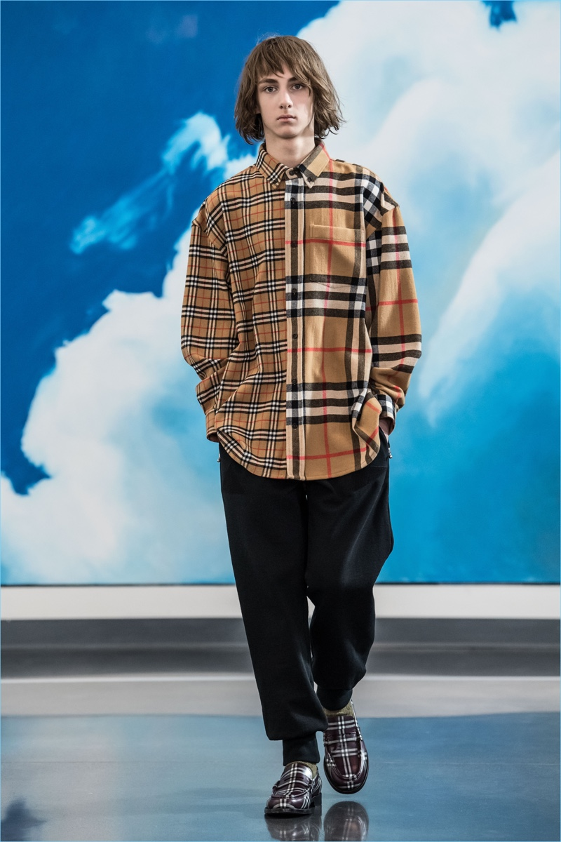 Burberry's iconic check comes together in two different scales for Gosha Rubchinskiy's fall-winter 2018 collaboration.