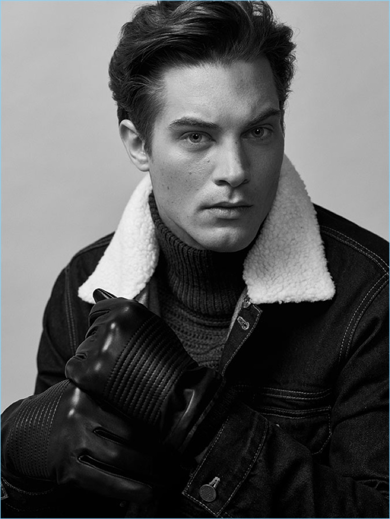 Model Greg Nawrat dons a turtleneck sweater and denim jacket from Reserved.