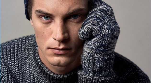 Front and center, Greg Nawrat wears knitwear from Reserved.