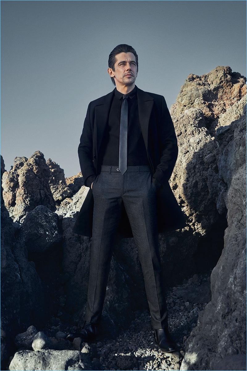 Clad in black, Werner Schreyer wears sharp trousers by Hiltl.