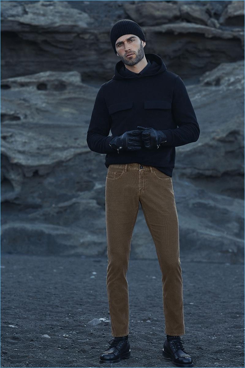 A casual vision, Christian Santamaria wears a pair of corduroy pants by Hiltl.