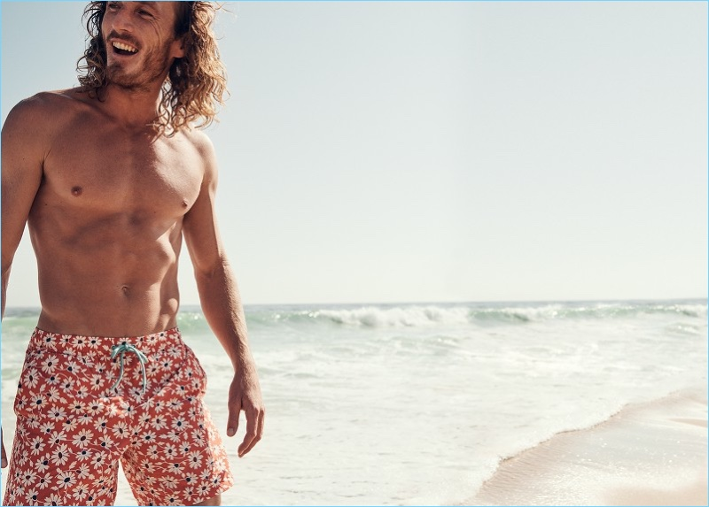 Ready for vacation, J.Crew proposes pink floral print swim trunks.