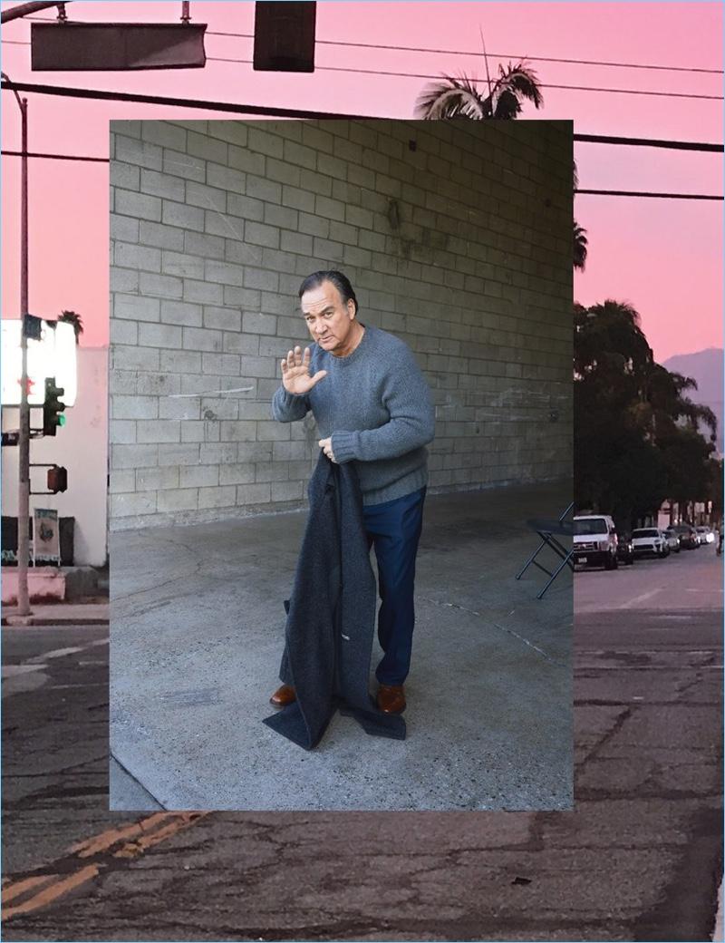Jim Belushi wears a Tom Ford coat, Berluti sweater, BOSS pants, and Church's shoes.