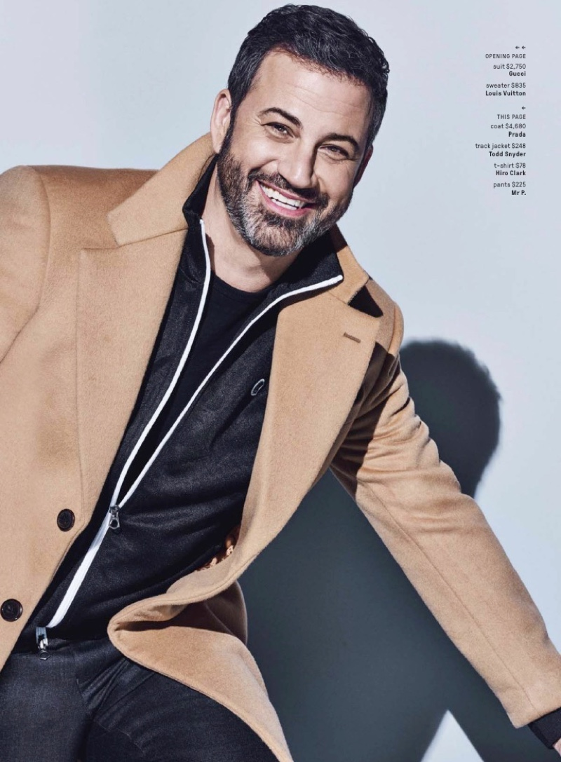 Late night host Jimmy Kimmel wears a Prada coat with a Todd Snyder track jacket. He also sports a Hiro Clark t-shirt and Mr. P pants.