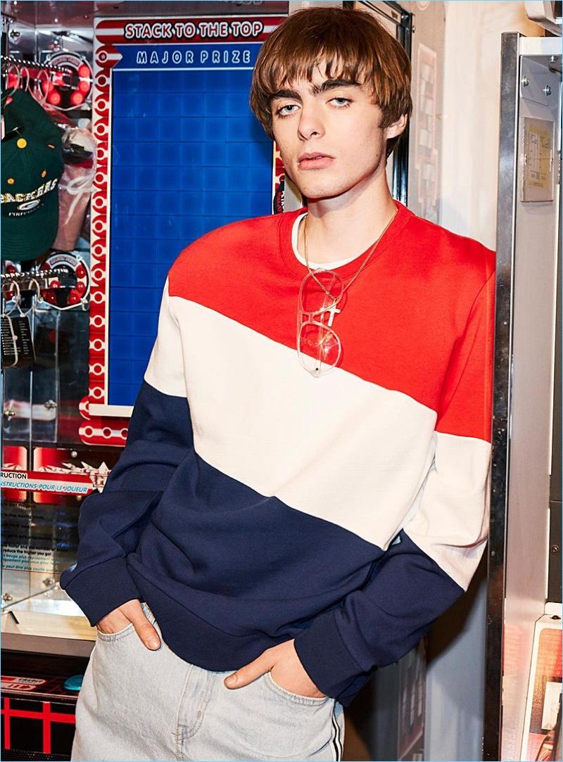 Lennon Gallagher sports a tricolor sweatshirt by DJAB with Triple J for Man tuxedo-stripe faded jeans.