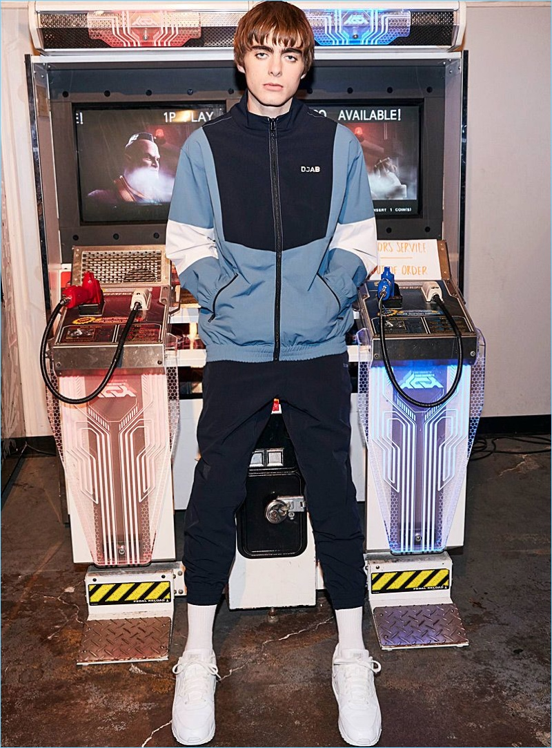 Model Lennon Gallagher wears a DJAB tracksuit with Nike Air Hurarache Run Ultra sneakers in white.