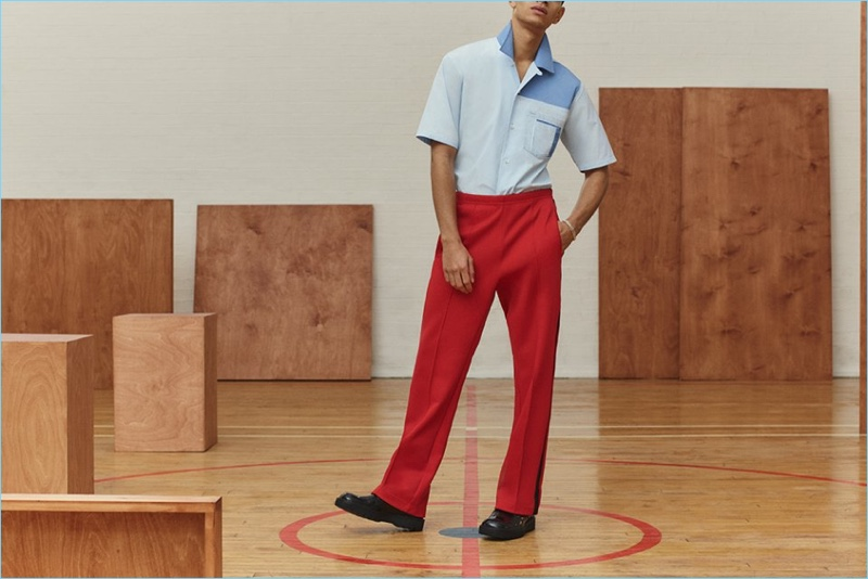Channel retro vibes in Maison Margiela's camp-collar shirt, drawstring trousers, and leather boots.