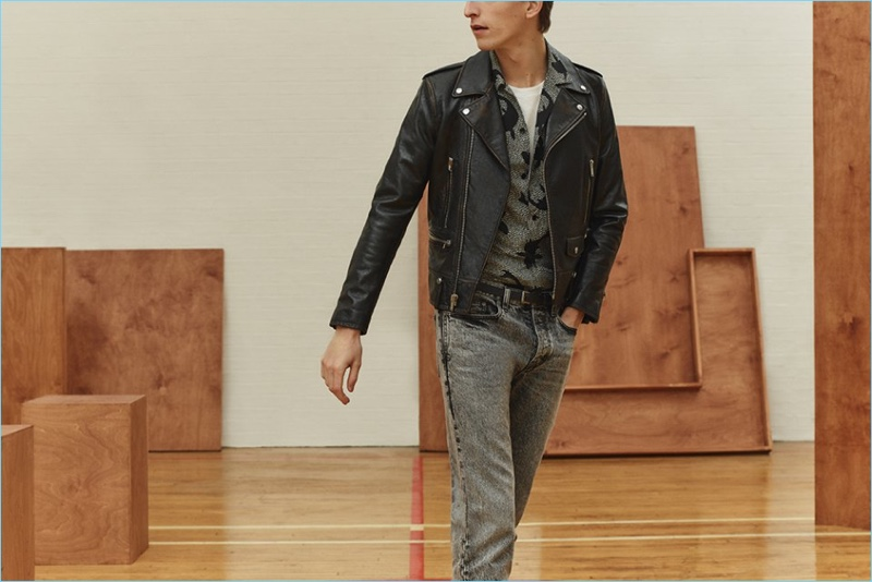 Tap into an easy cool with a leather biker jacket, camp-collar shirt, t-shirt, and acid wash jeans by Saint Laurent.