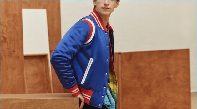 A varsity cool thrives with AMIRI's silk-satin bomber jacket, dip-dyed flannel shirt, t-shirt, and denim jeans.