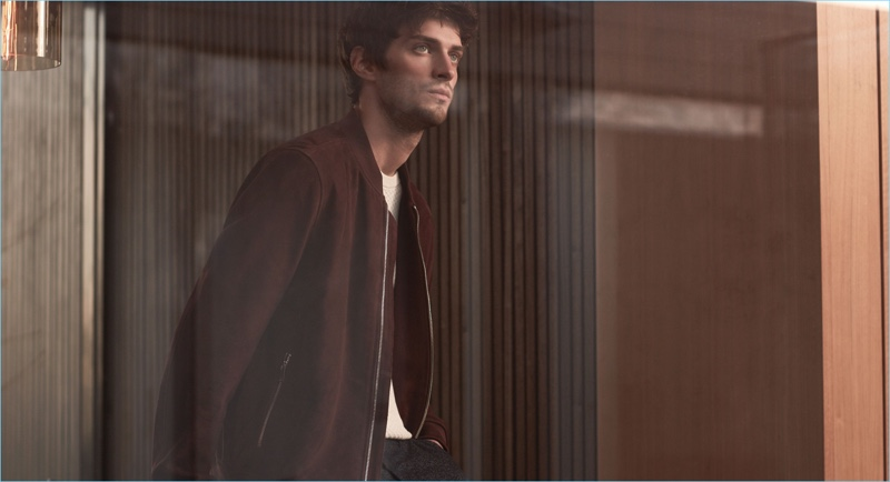 Making a case for suede, Matthew Bell wears Reiss' suede bomber jacket with a textured t-shirt and slim-fit trousers.