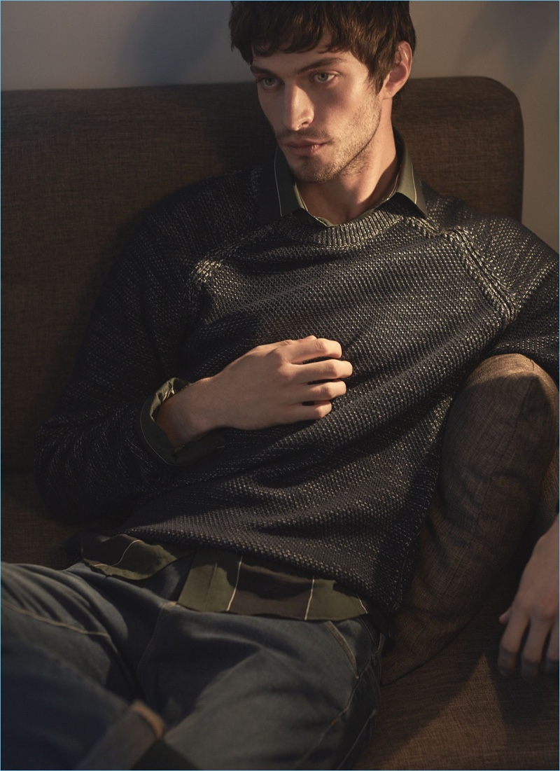British model Matthew Bell gets comfortable in a Reiss sweater, striped shirt, and slim-fit jeans.