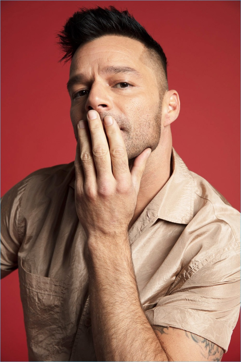 Connecting with Out magazine, Ricky Martin wears a Hermès shirt.