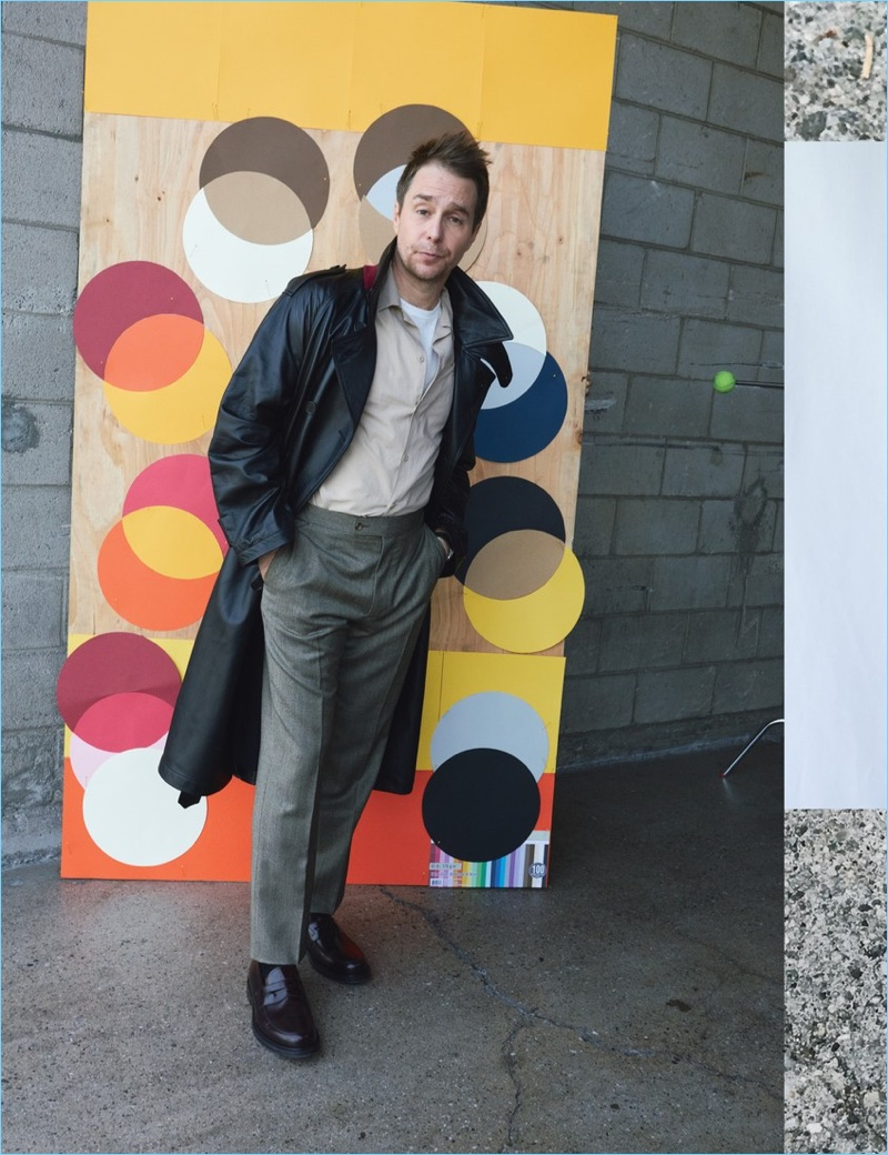 Sam Rockwell wears a Marni trench and Editions M.R shirt. He also sports a Simon Miller t-shirt, Huntsman pants, Rolex watch, and Church's shoes.