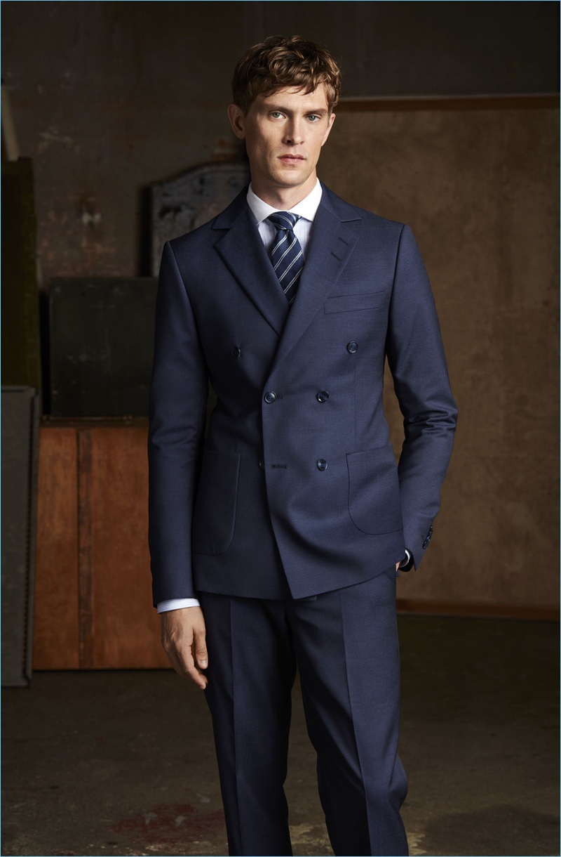 Donning a sharp suit, Mathias Lauridsen fronts Tiger of Sweden's spring-summer 2018 campaign.