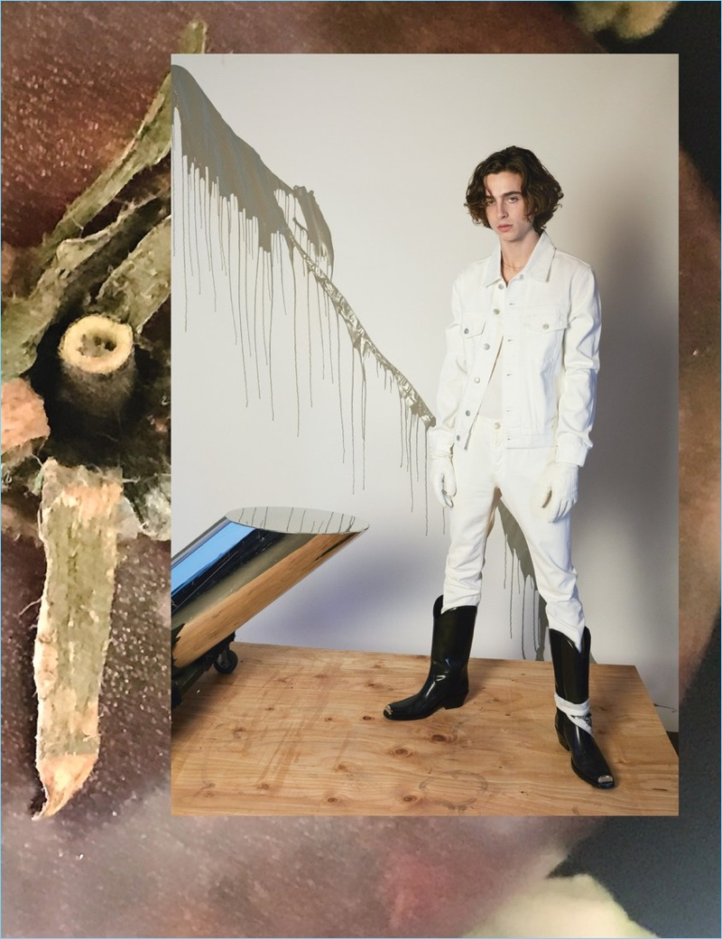 Timothée Chalamet wears a Sandro jacket and pants. A Schiesser tank top, Sermoneta Gloves gloves, and Calvin Klein 205W39NYC boots complete his look.