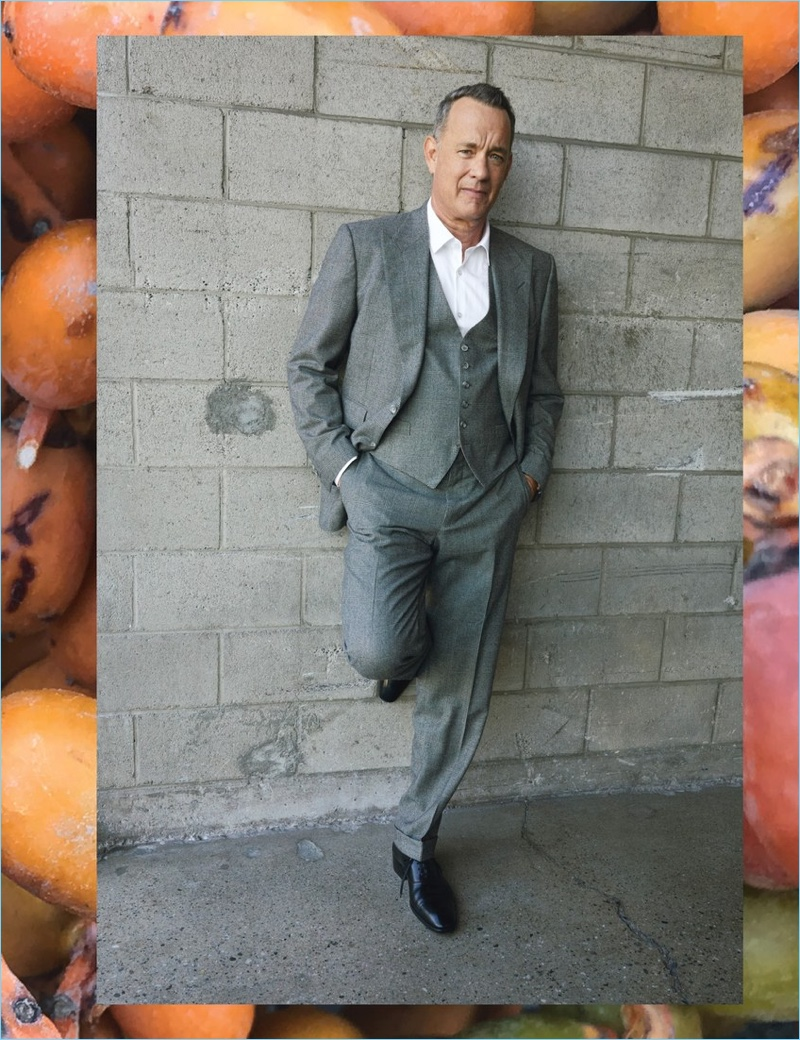 Tom Hanks wears a Tom Ford suit, vest, and shoes. The American actor also dons a BOSS shirt and Rolex watch.