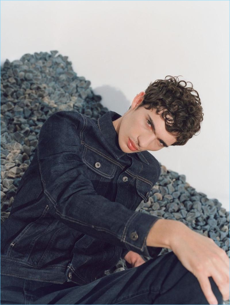Sporting blue denim, Piero Mendez fronts AG Jeans' spring-summer 2018 campaign.