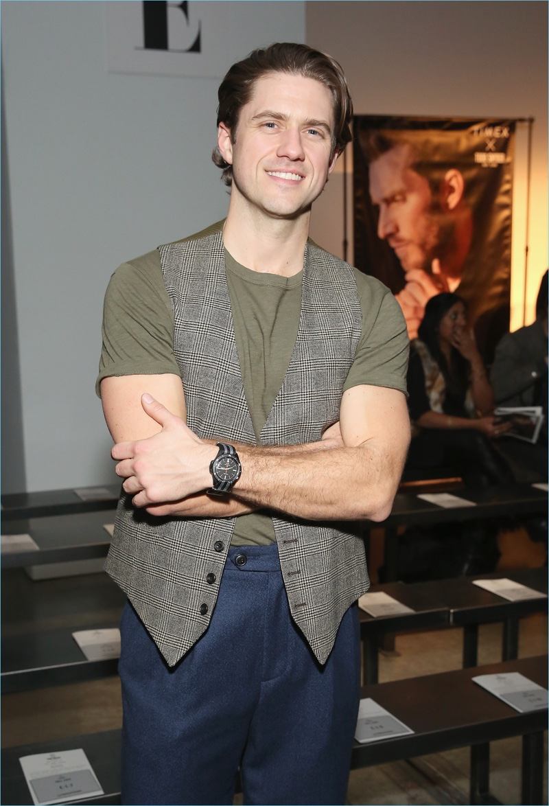 Aaron Tveit sports the Todd Snyder x Timex MS1 Maritime sport watch.