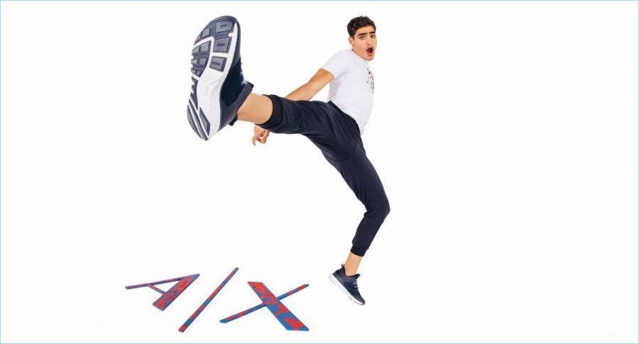 Throwing up a high kick, Jhonattan Burjack sports new pieces by Armani Exchange.