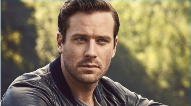Starring in a new photo shoot, Armie Hammer wears a Dolce & Gabbana bomber jacket. He also rocks a H&M henley, Chopard watch, and Louis Vuitton pants.