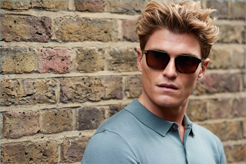 Sporting sunglasses, Oliver Cheshire stars in Marks & Spencer's spring-summer 2018 Autograph campaign.
