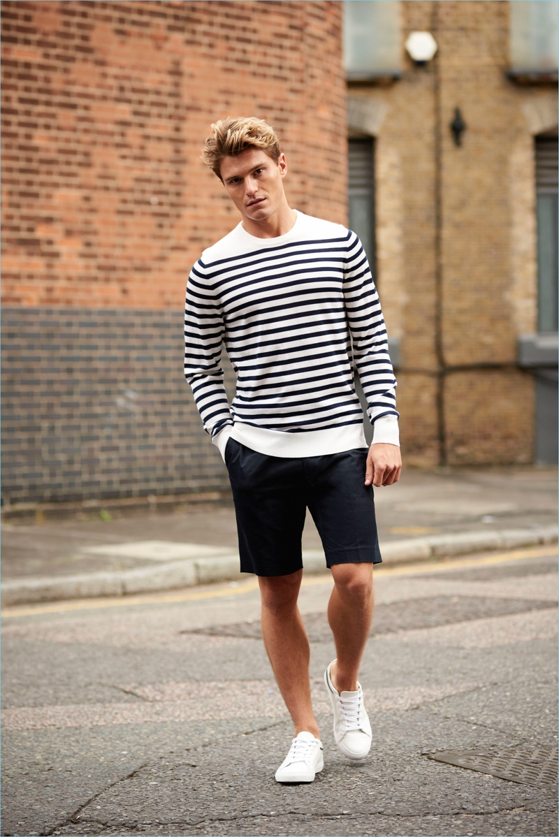 Donning a Breton stripe sweater and shorts, Oliver Cheshire wears a look by Autograph.