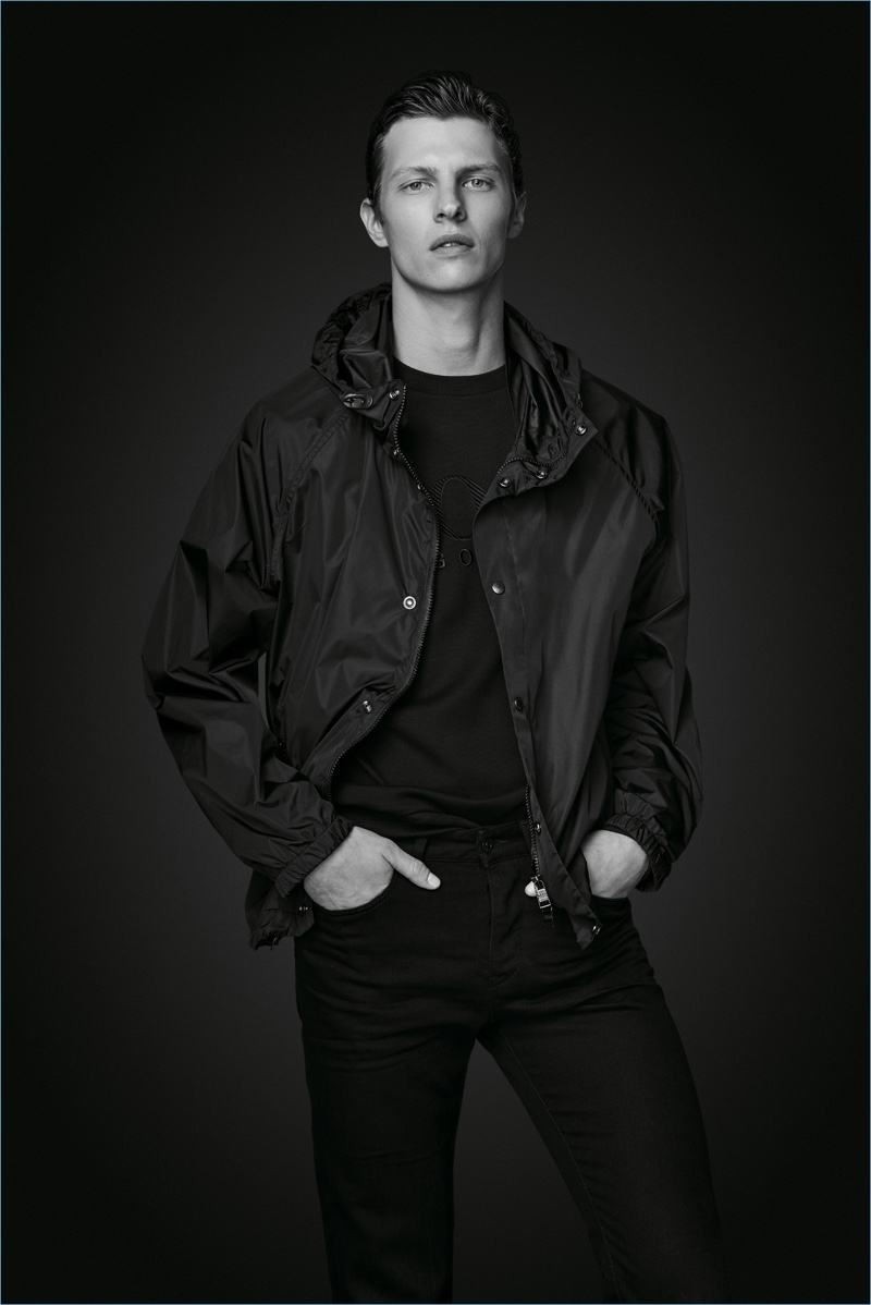 Tim Schuhmacher wears a windbreaker and jeans from BOSS' Black Edition capsule collection.