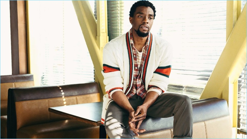 Embracing preppy style, Chadwick Boseman wears a Gucci cardigan with a Remi Relief flannel shirt. He also wears a Handvaerk striped t-shirt and Officine Generale chinos.