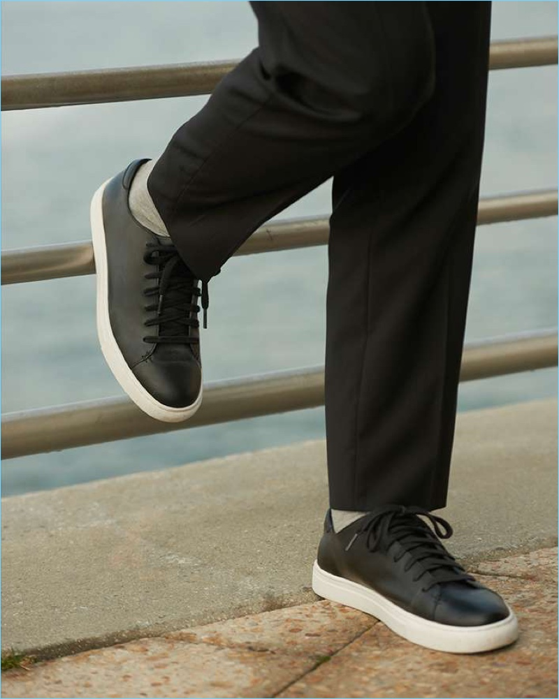 Dress down Club Monaco's wool trousers with its black leather sneakers.